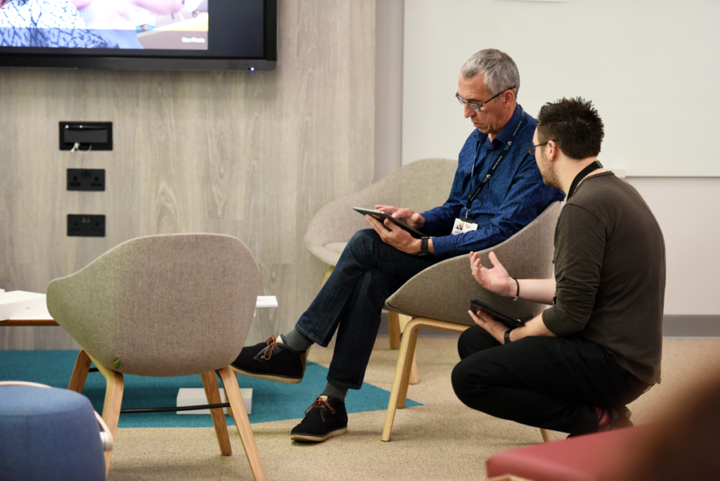 A member of the Digital Learning Team talks to an academic member of staff about their use of technology