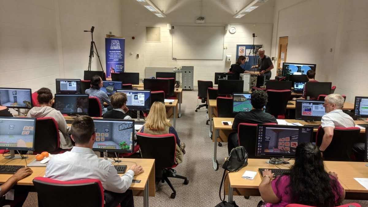 Workshop attendees busy exploring the world of Minecraft during the hands-on session.