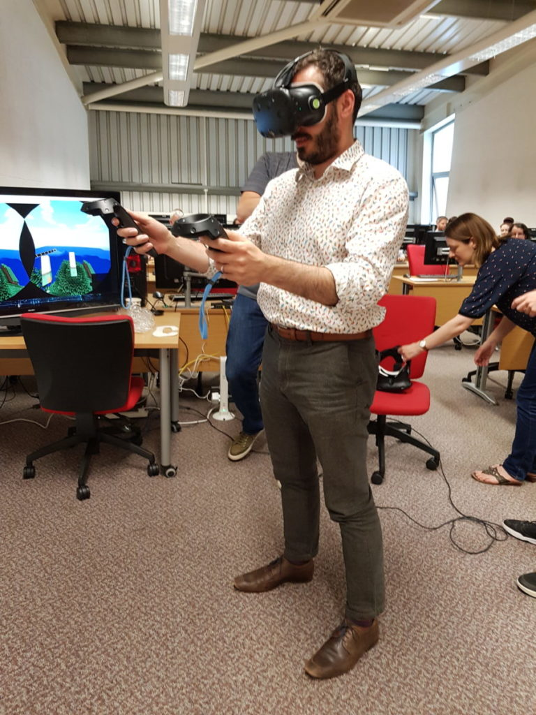 Prof Tim Thompson (Associate Dean Learning & Teaching, SSED) testing the VR goggles to navigate Minecraft world.